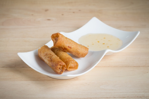 Deep fried spring rolls with pork stuffed serve with sweet sauce Premium Photo