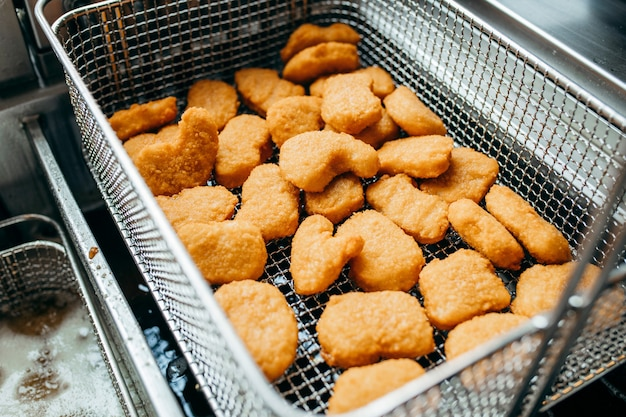 Deep fryers and grill, equipment of a fast food restaurant Premium Photo