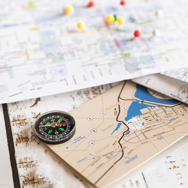 Defocused background map with old map on front Free Photo