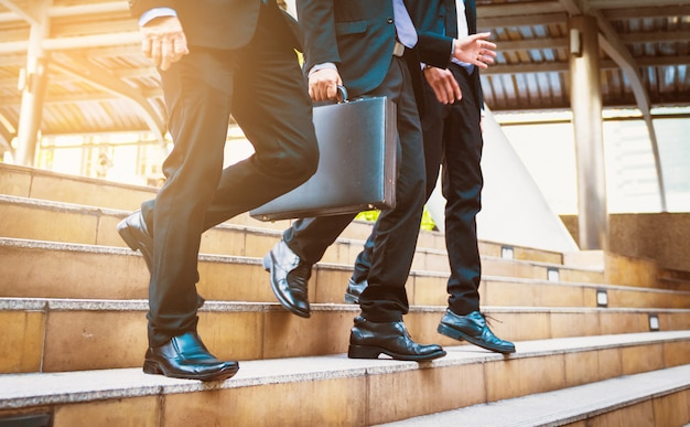 Defocused or blured businessman walking the stairs with city background, businessmen go to success concept, vintage style. Premium Photo