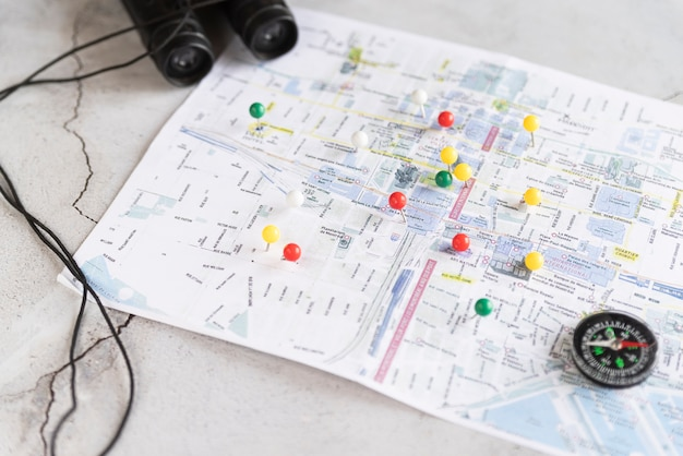 Defocused map with pinpoints Free Photo