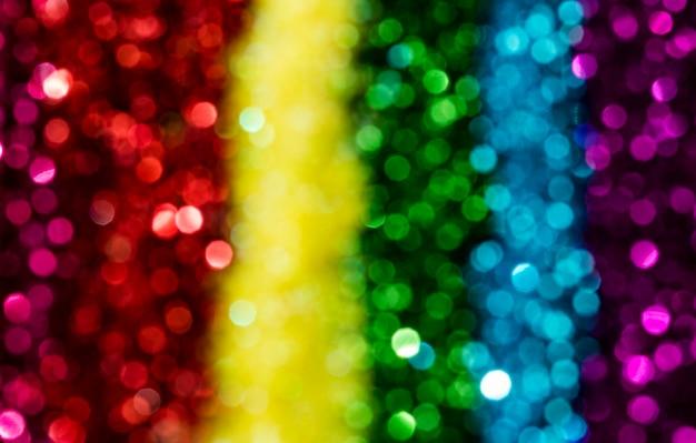 Glitter arcobaleno riflettente sfocato Foto Gratuite