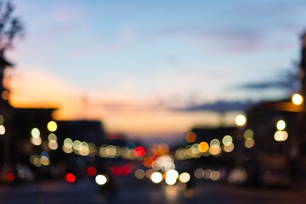 Defocused traffic and city lights on urban big street at dusk Premium Photo