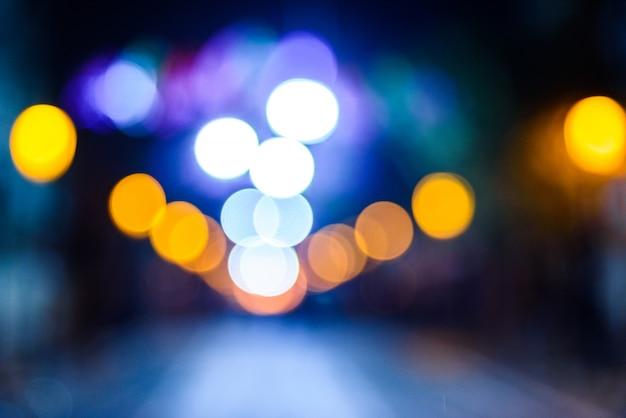 Defocused urban night with colorful circles. Premium Photo