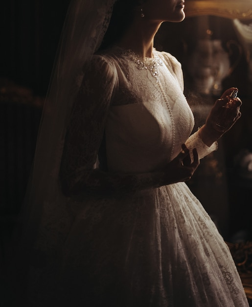 Delicate pearls on bride's beautiful dress Free Photo