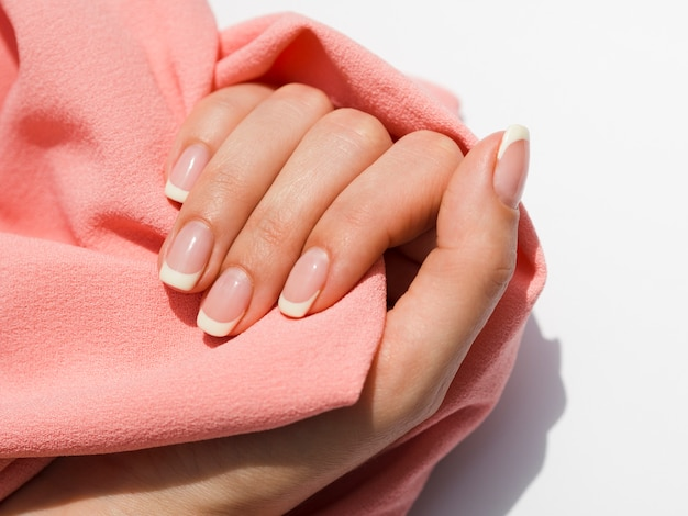 Delicate woman hand holding soft fabric Free Photo