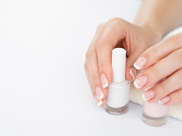 Delicate woman's hands with copy space Free Photo