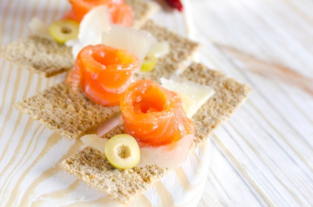 Delicious appetizer canapes with salmon and cheese Premium Photo