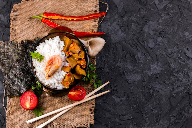 Delicious asian rice and shrimp dish with copy space Free Photo