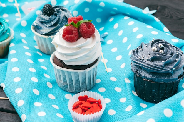 Delicious assortment of beautiful cupcakes close up Premium Photo