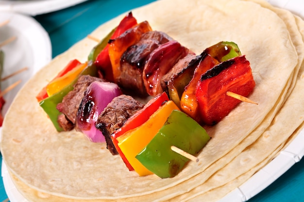 Delicious bbq skewer with beef and vegetables Free Photo