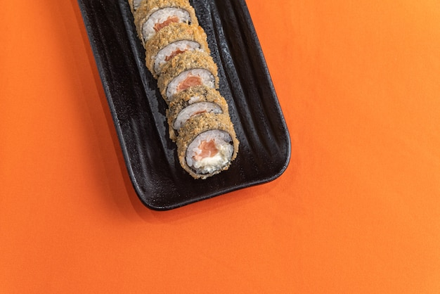 Delicious and beautiful sushi on the orange table Free Photo