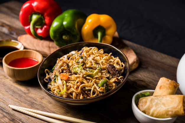 Delicious beef teriyaki with udon noodles and sesame seed garnish on wooden desk Free Photo