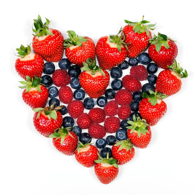 Delicious berries. strawberries, blueberries and raspberries. Free Photo
