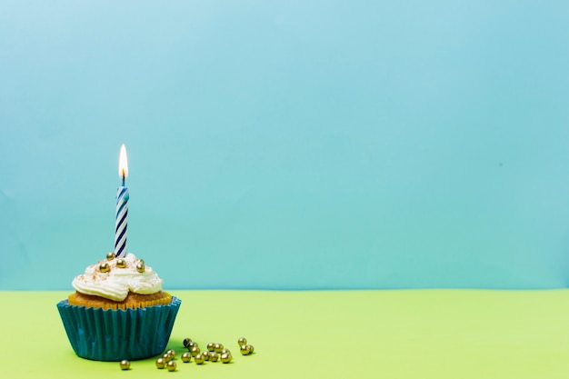 Delicious birthday cupcake with copy space Free Photo