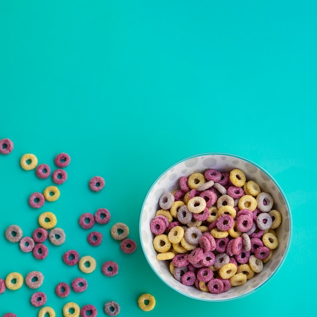 Delicious bowl of cereals on blue background Free Photo