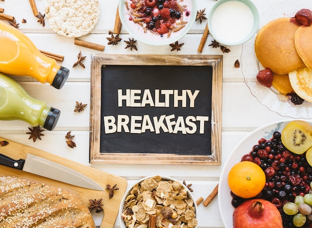 Delicious breakfast composition with slate Free Photo