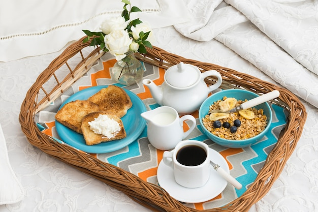 Delicious breakfast tray on bed Free Photo