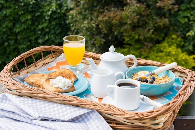 Delicious breakfast tray in the garden Free Photo