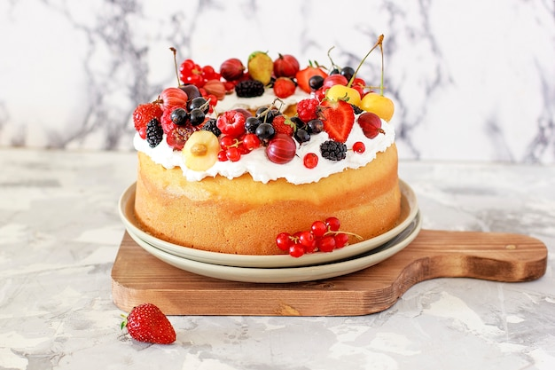 Delicious bundt cake with berries close-up Free Photo