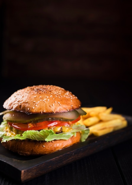 Delicious burger with french fries Free Photo