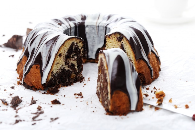 Delicious cake with chocolate on white Free Photo
