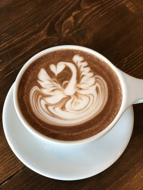 Delicious cappuccino with a beautiful painting on the foam Free Photo