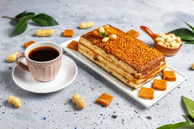 Delicious caramel and peanut cake with peanuts and caramel candies,top view Free Photo