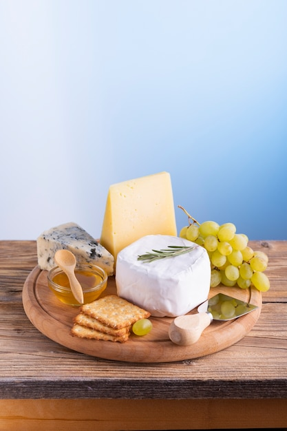Delicious cheese and grapes on a table Free Photo