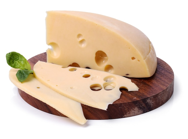 Delicious cheese on wooden board Free Photo