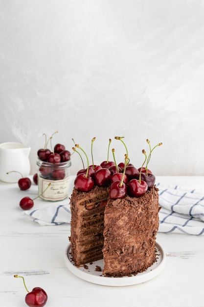 Delicious chocolate cake decorated with cherries, copy space Premium Photo