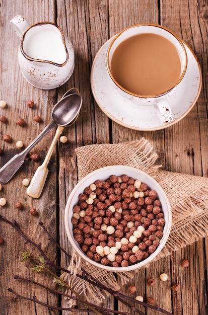 Delicious chocolate corn balls in milk. Premium Photo