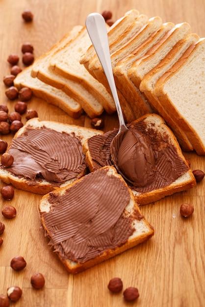 Delicious chocolate cream on a toast Free Photo