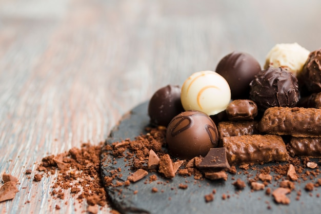 Delicious chocolates on slate plate Free Photo