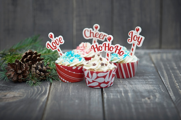 Delicious christmas muffins on the wood Free Photo