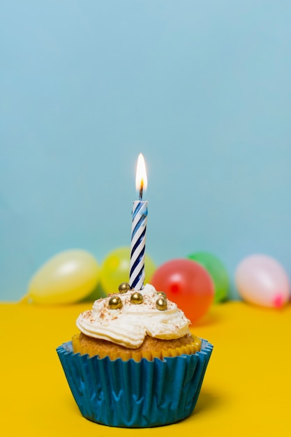 Delicious cupcake on table for birthday party Free Photo