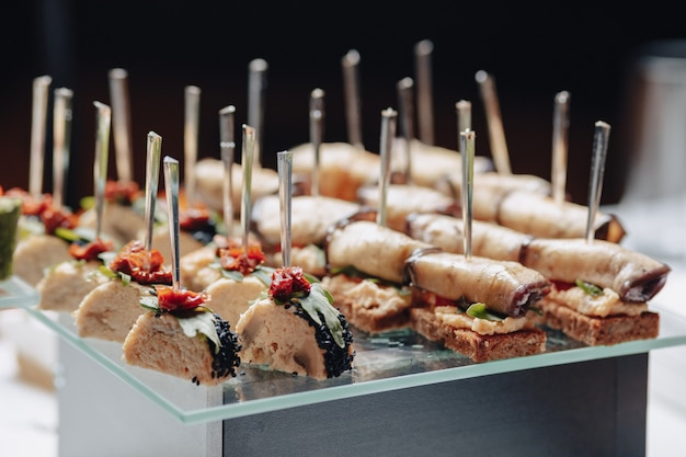 Delicious festive buffet with canapes and different delicious meals Premium Photo