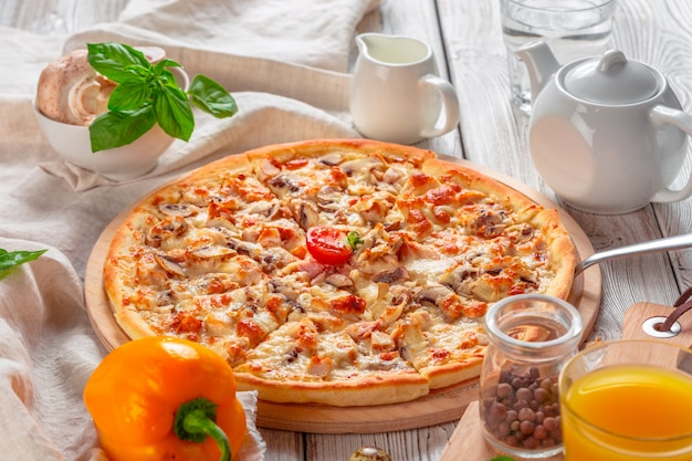 Delicious fresh pizza served on wooden table Premium Photo