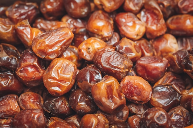 Delicious fresh and sweet sukkari dates Premium Photo