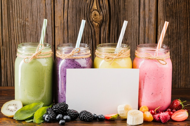 Delicious fruit and smoothies composition with copy space Free Photo