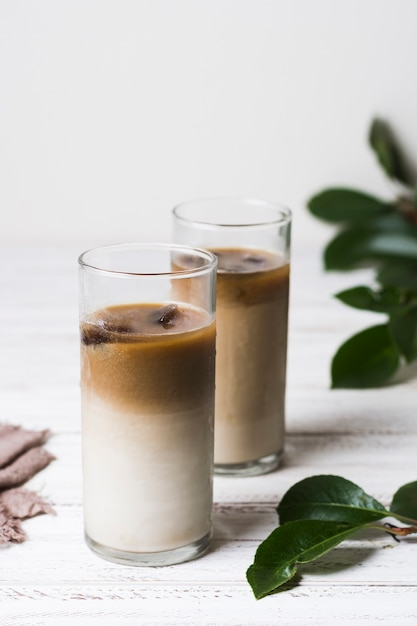Delicious glasses with coffee and ice cubes Free Photo