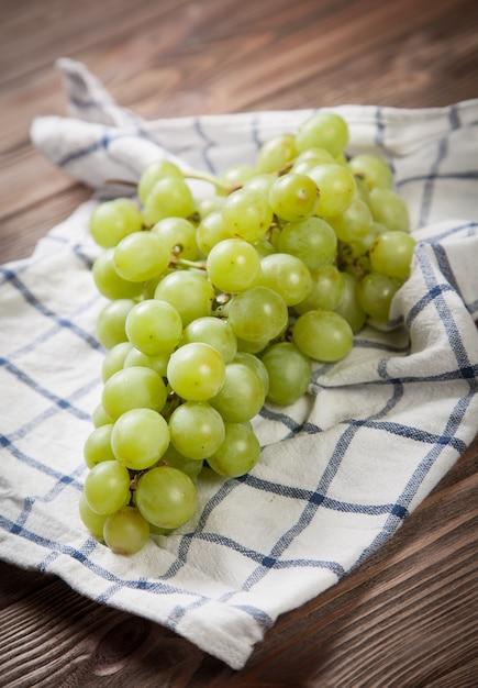 Premium Photo Delicious Grapes On A Kitchen Table