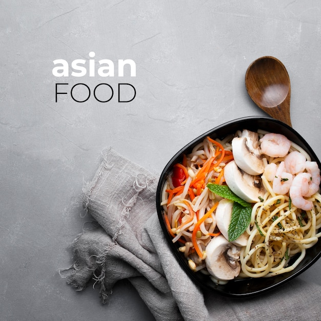 Delicious and healthy asian food on a gray textured background Free Photo