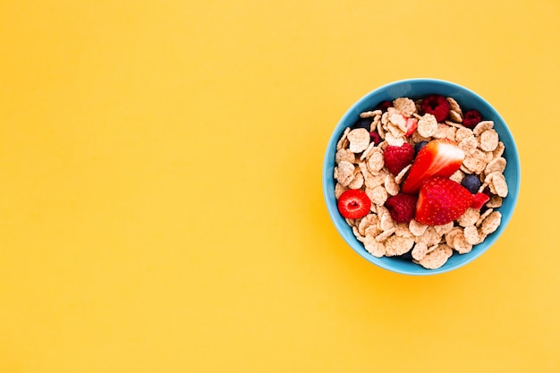 Delicious healthy breakfast on a yellow background Free Photo
