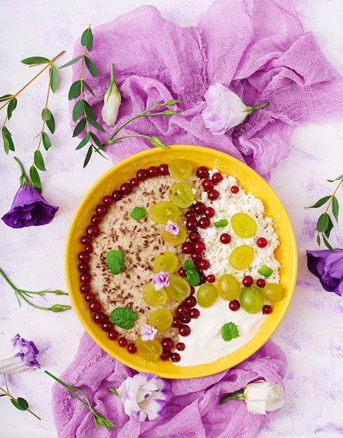 Delicious and healthy oatmeal with grapes, yogurt and ...