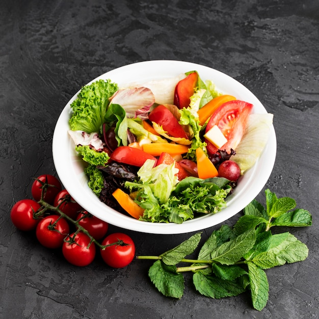 Delicious healthy salad on grunge background Free Photo