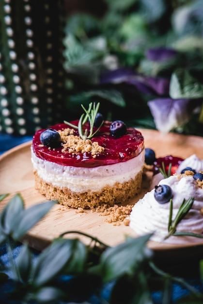 Delicious homemade cheesecake with berry sauce. Premium Photo