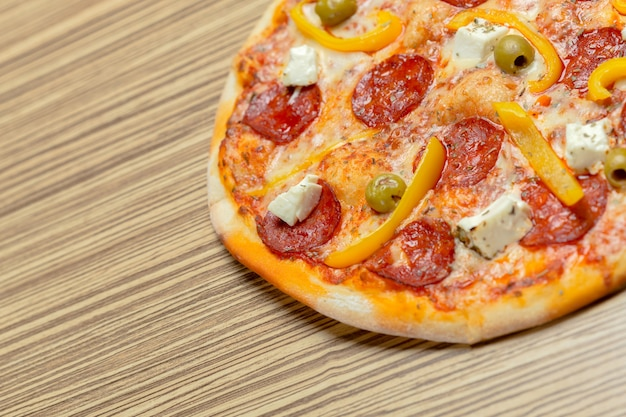 Delicious italian pizza served on wooden table Premium Photo
