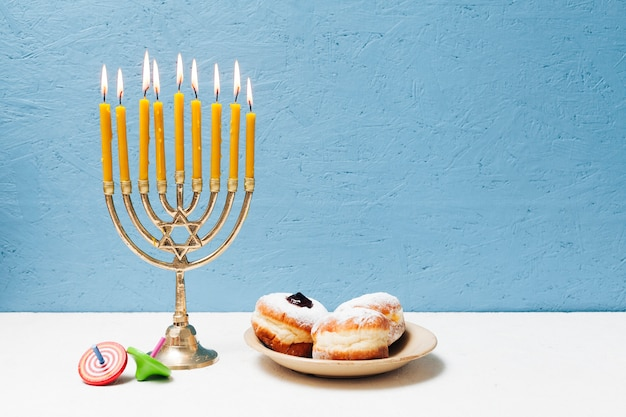Delicious jewish sweets with menorah Free Photo