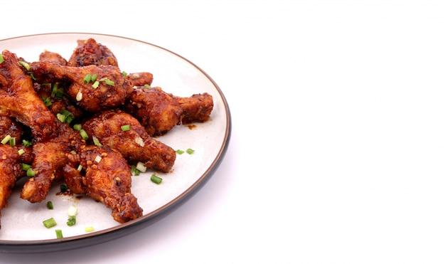 Delicious korean fried chicken on a white background. Premium Photo
